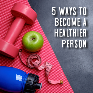 5 ways to become a healthier person. yoga mat, apple, water bottle, and bumbell.